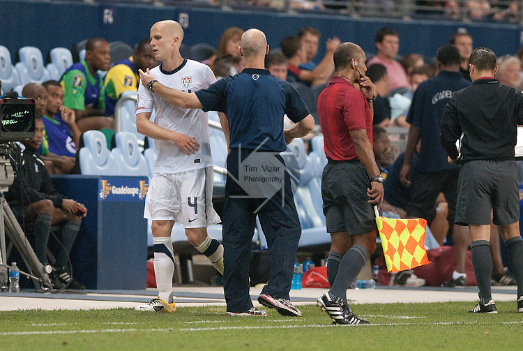 14 June 2011                          USA head coach Bob Bradley congratulates his son, USA midfielder Michael Bradley (4) as he came off the field late in the game. The USA Men's National Soccer Team defeated the Guadeloupe Men's National Soccer Team 1-0 in the first qualifying round of the CONCACAF Gold Cup game at Livestrong Sporting Park in Kansas City, KS on June 14, 2011.