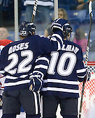 Stevie Moses (UNH - 22) and Dalton Speelman (UNH - 10) celebrate Moses' goal which made it 2-0 UNH midway through the second period. - The visiting University of New Hampshire Wildcats defeated the University of Massachusetts-Lowell River Hawks 3-0 on Thursday, December 2, 2010, at Tsongas Arena in Lowell, Massachusetts.