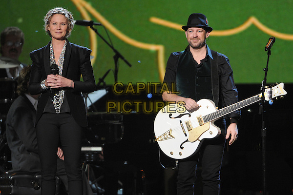 """JENNIFER NETTLES of Sugarland.""""CMA Country Christmas"""" Taping held at Bridgestone Arena, Nashville, Tennessee, USA..November 11th, 2010.stage concert live gig performance singing full length black suit jacket trousers singing.CAP/ADM/LF.©Laura Farr/AdMedia/Capital Pictures."""