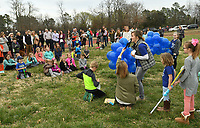NWA Democrat-Gazette/ANDY SHUPE<br /> Parents, teachers and students at Vandergriff Elementary School read Thursday, March 16, 2017, from a list of favorite qualities of Adron Benton during a balloon release at the Bob Kraynik Community Sports Complex at the school in Fayetteville. The event was held in remembrance and celebration of Adron, a 6-year-old student at Vandergriff who was found in a nearby swimming pool March 7 and later died.
