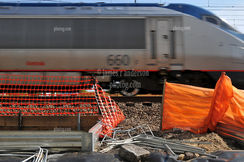 Amtrak Acela passing thru the Under Construction Railroad Station at Fairfield Metro Center