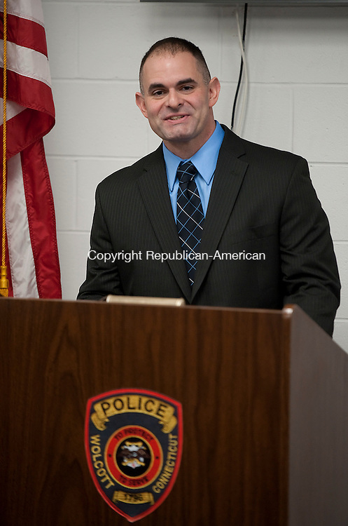 WOLCOTT,  CT-011717JS02--Police Officer Justin Martella thanks guests, staff fellow officers after being sworn into the Wolcott Police Department during a ceremony Tuesday at the Wolcott Police Department. <br />  Jim Shannon Republican-American