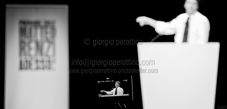 Matteo Renzi is seen gesturing on a TV camera display during his political campaign convention for the Partito Democratico's primary elections - The Italian left wing Party - in Turin, October 21, 2012.