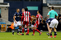 Tempers flare at the final whistle as Millwall's George Saville and Romaine Sawyers of Brentford confront one another during Millwall vs Brentford, Sky Bet EFL Championship Football at The Den on 10th March 2018