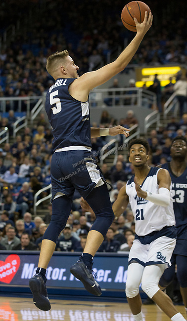Utah State guard Sam Merrill (5) lays the ball up against as Nevada's Jordan Brown (21) looks on in the second half of an NCAA college basketball game in Reno, Nev.,  Wednesday, Jan. 2, 2019. (AP Photo/Tom R. Smedes)