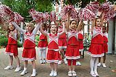 Cheerleaders perform at Fisherton Estate street party, London