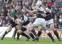 Sport - Rugby 27/04/2002 Parker Pen Shield - Semi-Final.London Irish vs Pontypridd - Kassam Stadium - Oxford.Justin Bishop holds up Ceri Sweeney..[Mandatory Credit, Peter Spurier/ Intersport Images].