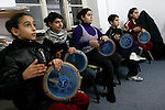 "FOR FAOIROUZ SONG ""THE FLOWER OF THE CITIES"" - Palestinians take part in a Darbuka drum lesson in the Edward Said National Conservatory of Music in East Jerusalem. Photo by Quique Kierszenbaum."