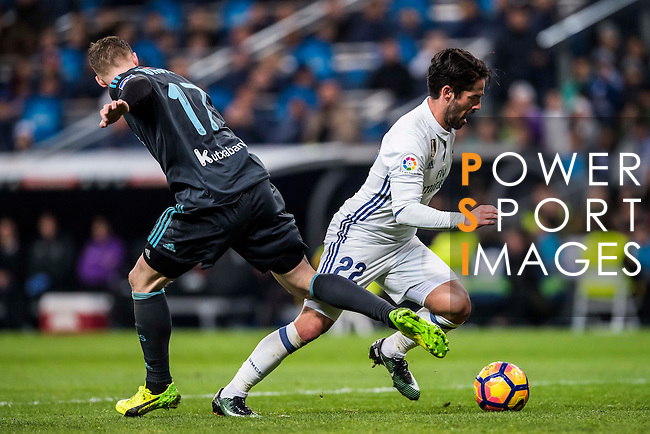 Isco Alarcon (r) of Real Madrid vies for the ball with David Zurutuza Veillet of Real Sociedad during their La Liga match between Real Madrid and Real Sociedad at the Santiago Bernabeu Stadium on 29 January 2017 in Madrid, Spain. Photo by Diego Gonzalez Souto / Power Sport Images