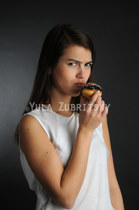 Hanukkah - woman with chocolate Doughnut Hanukkah - donuts