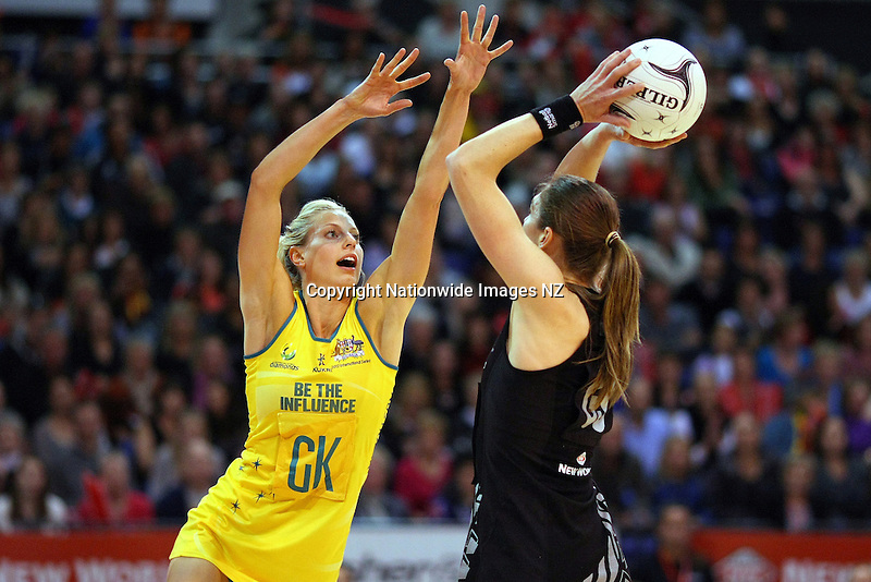 Australia's Laura Geitz, left, defends New Zealand's Irene Van Dyk's shot at goal in the New World netball series test match, CBS Canterbury Arena, Christchurch, New Zealand, Sunday, September 23, 2012. Credit:NINZ / Dianne Manson.