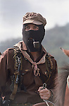 Zapatista sub commander Marcos shown smoking his trademark pipe at his stronghold of La Realidad in the jungles of Chiapas, Mexico shortly after the Zapatista uprising of New Year's Day, 1994.