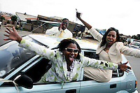 SOWETO, SOUTH AFRICA OCTOBER 28: Unidentified people cheer as they are driving to a wedding party on October 28, 2006 in Diepkloof section of Soweto, Johannesburg, South Africa. Locals like lavish weddings and they are usually a long affair, with a traditional wedding and visits to both the man and woman&rsquo;s parents, and many also have a typical western wedding. Soweto is South Africa&rsquo;s largest township and it was founded about one hundred years to make housing available for black people south west of downtown Johannesburg. The estimated population is between 2-3 million. Many key events during the Apartheid struggle unfolded here, and the most known is the student uprisings in June 1976, where thousands of students took to the streets to protest after being forced to study the Afrikaans language at school. Soweto today is a mix of old housing and newly constructed townhouses. A new hungry black middle-class is growing steadily. Many residents work in Johannesburg but the last years many shopping malls have been built, and people are starting to spend their money in Soweto.  <br /> (Photo by Per-Anders Pettersson)