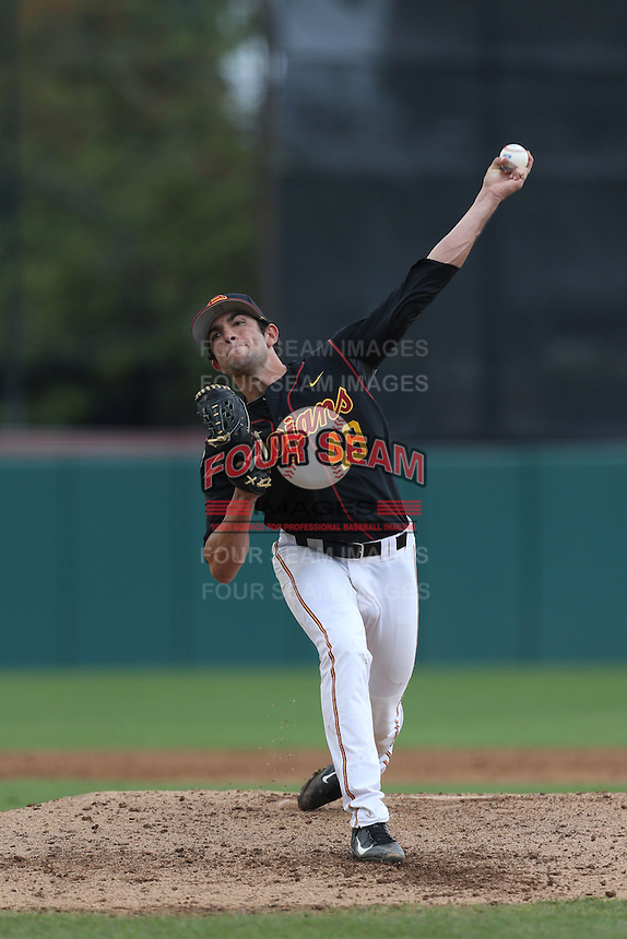 Marc Huberman #49 of the USC Trojans pitches against the Cal Poly Mustangs at Dedeaux Field on March 2, 2014 in Los Angeles, California. Cal Poly defeated USC, 5-1. (Larry Goren/Four Seam Images)