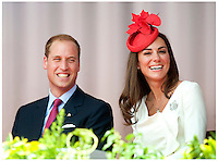 Prince William, Duke of Cambridge and Catherine, Duchess of Cambridge  at Parliament Hill for Canada Day Noon Show Celebrations on July 01, 2011 in Ottawa, Canada. Kate wore a Reiss dress, red Lock&Co hat and Anya Hindmarch fan bag with red pumps...Tel: 07515 876520.e mail: info@kisforkate.com