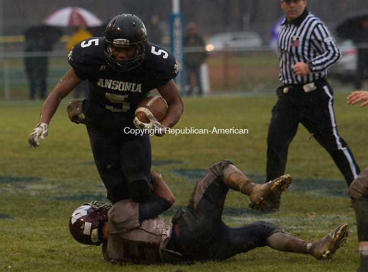 ANSONIA, CT.- 06 DECEMBER 2014 - 120614JW06 - Ansonia #5 Tyler Baily gets wrapped up by Windham #15 Joseph Santiago during the Class S Large semifinal game at Jarvis Field Saturday afternoon. Ansonia won 35-14.<br /> Jonathan Wilcox Republican-American