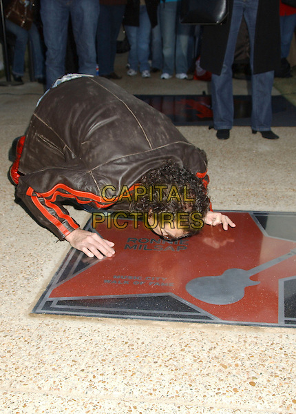 RONNIE MILSAP .Music City Walk of Fame Class of 2006 Induction held at the Hall of Fame Park, Nashville, Tennessee , USA..November 5th, 2006.Ref: ADM/LF.full length kneeling jeans denim crouching kiss.www.capitalpictures.com.sales@capitalpictures.com.©Laura Farr/AdMedia/Capital Pictures.