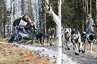 Mike Santos concentrates on the trail as he runs down a bare stretch along the bike/ski trail during the cermonial start day of Iditarod 2015 in Anchorage, Alaska. Saturday March 7, 2015<br /> <br /> (C) Jeff Schultz/SchultzPhoto.com - ALL RIGHTS RESERVED<br />  DUPLICATION  PROHIBITED  WITHOUT  PERMISSION