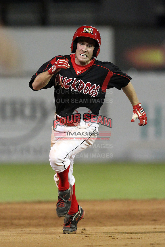 Batavia Muckdogs outfielder Mike O'Neil (26) scores the winning run during a game vs. the Lowell Spinners at Dwyer Stadium in Batavia, New York July 16, 2010.   Batavia defeated Lowell 5-4 with a walk off RBI single in the bottom of the 9th inning.  Photo By Mike Janes/Four Seam Images