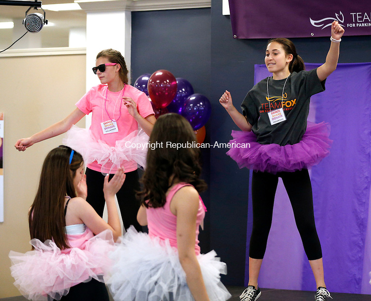 Waterbury, CT- 14 June 2015-061415CM11- Zoe Butchern, 14, of Ridgefield, right, and Avery Buckanavage, 14, of Ridgefield, back left,  dance during A Shake-It-Off-A-Thon, to benefit the Michael J. Fox Foundation for Parkinson's research at Raymour & Flanigan in Waterbury on Sunday.  Butchen a student at Ridgefield High School said 100% of the proceeds will go to the Michael J. Fox Foundation for Parkinsons.  Her father, Jeff Butchen was diagnosed with the disease, an event that inspired her to raise money for the foundation.   Christopher Massa Republican-American