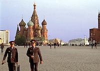 Two Russian soldiers stroll in Red Square; St. Basil's Cathedral in the distance. Red Square, Moscow, Russia.
