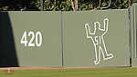Someone taped the outline of outfielder Henry Ramos in the outfield wall where he crashed Friday night chasing a fly ball.  (Tom Priddy/Four Seam Images)