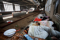 Workers sleep in the newly being constructed larger factory at Amity Printing Co in Nanjing, 03 Dec 2007,  which is a joint venture with the United Bible Society that produces millions of bibles annually.<br />
