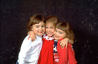 Girlfriends hugging after Christmas pageant age 5.  WesternSprings  Illinois USA