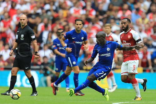 August 6th 2017, Wembley Stadium, London, England; FA Community Shield Final, Arsenal versus Chelsea; Ngolo Kante of Chelsea passes the ball under pressure from Alexandre Lacazette of Arsenal