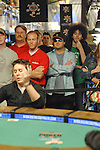 Poker pro Alex Jacob tries to get a better view