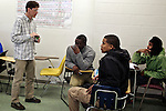 Greg Wahl, left, associate professor at Montgomery College, works with students including Alie Kamara, center, Elio Perdomo, center right, and Tony Jones, right, in his Basic Writing II class, as they started working on their final project. If students pass this class, it allows them to progress to the college level english program. Otherwise students will face the decision to take the remedial class again or drop out.