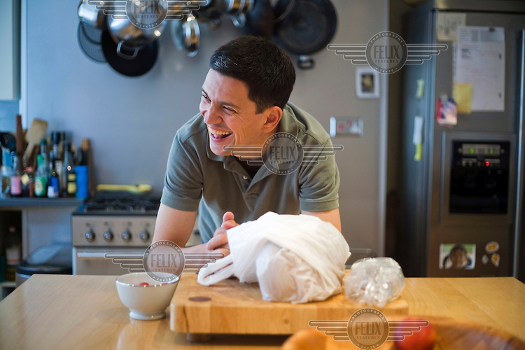 David Miliband, British Foreign and Commonwealth Secretary, in the kitchen at his home in London.