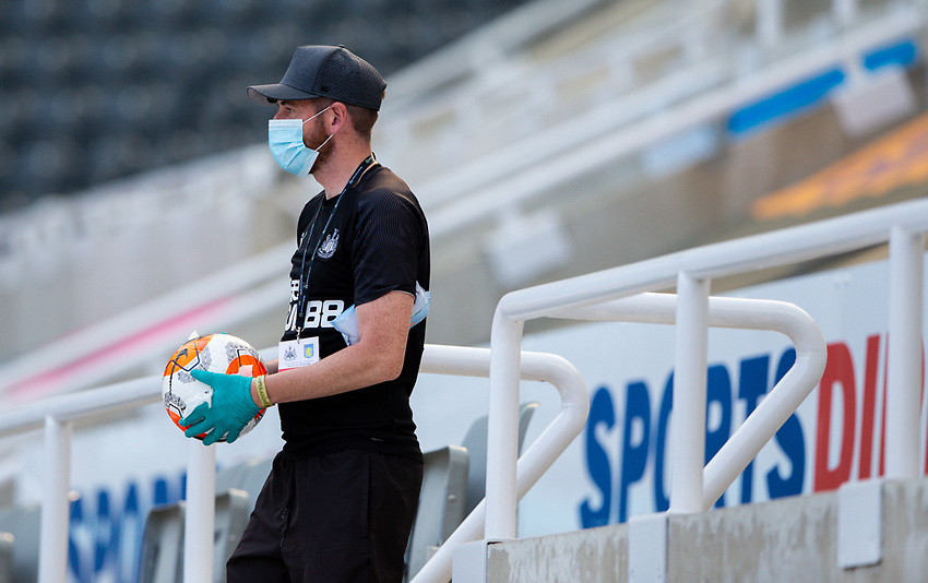 A member of the Newcastle United team cleans a match ball<br /> <br /> Photographer Alex Dodd/CameraSport<br /> <br /> The Premier League - Newcastle United v Aston Villa - Wednesday 24th June 2020 - St James' Park - Newcastle <br /> <br /> World Copyright © 2020 CameraSport. All rights reserved. 43 Linden Ave. Countesthorpe. Leicester. England. LE8 5PG - Tel: +44 (0) 116 277 4147 - admin@camerasport.com - www.camerasport.com