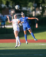 In a National Women's Soccer League Elite (NWSL) match, the Boston Breakers defeated the FC Kansas City, 1-0, at Dilboy Stadium on August 10, 2013.  FC Kansas City defender Lauren Sesselmann (14) and Boston Breakers forward Kyah Simon (17) compete for a head ball.