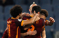 Calcio, Serie A: Roma vs Fiorentina. Roma, stadio Olimpico, 4 marzo 2016.<br /> Roma&rsquo;s Diego Perotti, back to camera, celebrates with teammates after scoring during the Italian Serie A football match between Roma and Fiorentina at Rome's Olympic stadium, 4 March 2016.<br /> UPDATE IMAGES PRESS/Riccardo De Luca