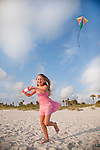USA Florida, Girl (8-9) flying kite on St. Pete Beach