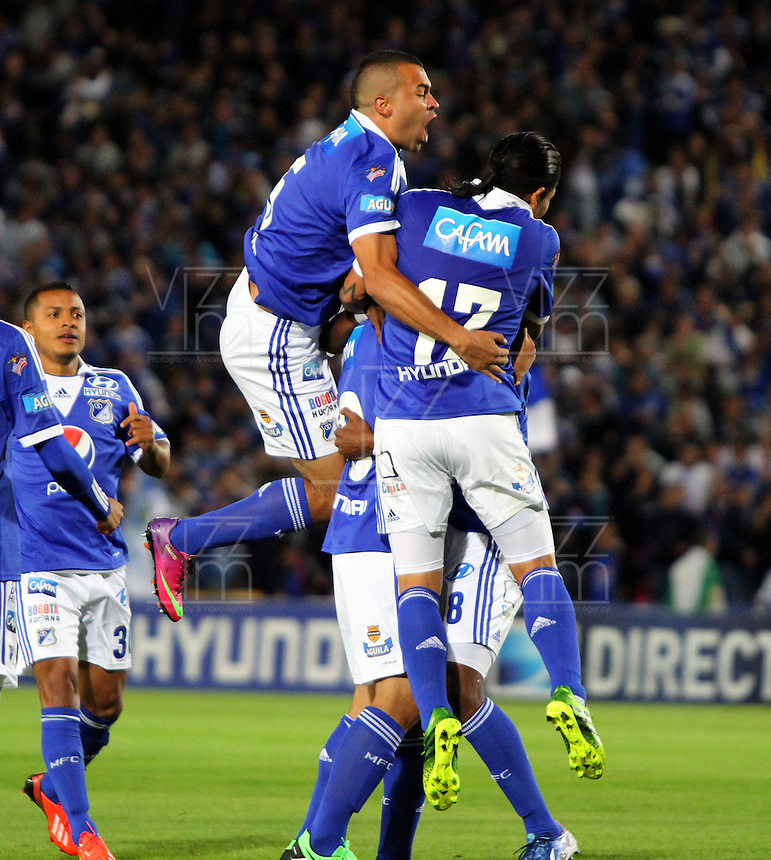 BOGOTA -COLOMBIA- 04-08-2013. Harrison Otlalvaro  de Millonarios  celebra su gol  contra el Independiente Medellin    ,  partido correspondiente a la Liga Postobón segundo semestre disputado en el estadio Nemesio Camacho El Campin     / Millionaires Harrison Otalvaro celebrates his goal against Independiente Medellin, game in the second half Postobón Liga match at the Estadio Nemesio Camacho El Campin<br />  . Photo: VizzorImage /Felipe Caicedo  / STAFF