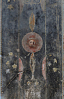 Fresco decoration with theatrical mask on the walls of the atrium, in the Casa di Casca Longus, or House of Casca Longus, Pompeii, Italy. The house is thought to be owned by Casca Longus, who also owned shops and workshops nearby. The fresco is in the Third Style of Roman wall painting, 20–10 BC, characterised by an ornamental elegance in figurative and colourful decoration. Pompeii is a Roman town which was destroyed and buried under 4-6 m of volcanic ash in the eruption of Mount Vesuvius in 79 AD. Buildings and artefacts were preserved in the ash and have been excavated and restored. Pompeii is listed as a UNESCO World Heritage Site. Picture by Manuel Cohen