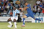 Getafe's Wanderson (r) and Malaga's Arthur Boka during La Liga match.September 18,2015. (ALTERPHOTOS/Acero)
