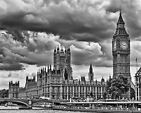 Looking from the River Thames at the Parliament Buildings in London in black and white.