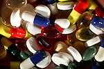 Multi-coloured tablets and capsules. Royalty Free