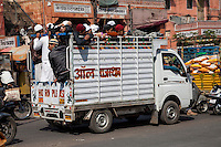 Jaipur, Rajasthan, India.  Mid-day Street Traffic in Central Jaipur.  A Small Lorry Transporting Boys.