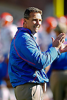 November 27, 2010:   Florida Gators head coach Urban Meyer urges his player on during warm ups prior to the start of the game between the ACC Conference Florida State Seminoles and the SEC Conference University of Florida Gators at Doak Campbell Stadium in Tallahassee, Florida.