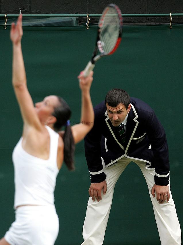 Photo: Paul Thomas..Wimbledon Championships. 27/06/2007..A Line judge watches closely as Jelena Jankovic serves.