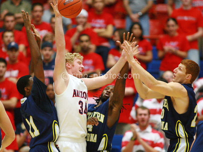 Nov 30, 2008; Tucson, AZ, USA; Arizona Wildcats forward Chase Budinger (34) is triple-teamed by three Northern Arizona Lumberjacks defenders in the first half of a game at the McKale Center.  Arizona won the game 74-57.