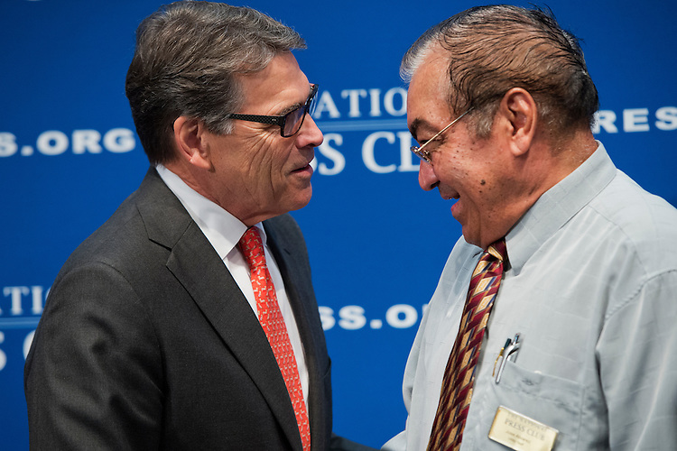 UNITED STATES - JULY 2: Former Gov. Rick Perry, R-Texas, candidate for president, greets retiring NPC employee Jose Alvarez before Perry addressed the National Press Club's Newsmaker Luncheon on his economic plan, July 2, 2015. (Photo By Tom Williams/CQ Roll Call)
