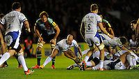 Peter Stringer of Bath Rugby passes from behind a ruck