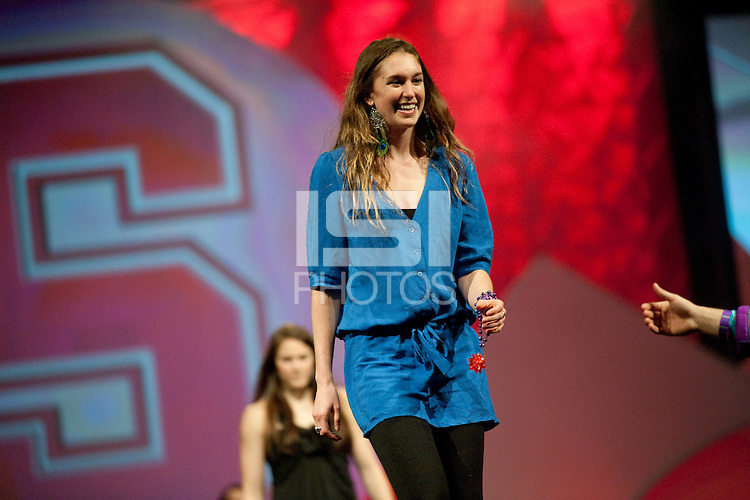 INDIANAPOLIS, IN - APRIL 1, 2011: Hannah Donaghe enjoys the festivities at the Cirque du Salute at the Indianapolis Convention Center at Tourney Town during the NCAA Final Four in Indianapolis, IN on April 1, 2011.