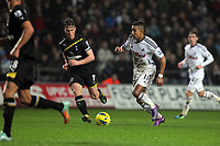 Pictured: Scott Sinclair of Swansea (R) is closely watched by Scott Parker (L) of Tottenham Hotspur. Saturday 31 December 2011<br />