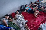 28 August 2019, Jakarta, Indonesia: - Afghan men sleep inside the UNHCR refugee centre in Kalideres, Jakarta. Plans to re-locate the overcrowded refugees have been fast tracked after a fight broke out between the groups, many of whom have been in Indonesia for years waiting for placement. Tensions ran high between Afghan and African groups in the centre with a lack of adequate food for the refugees being the catalyst. The African groups, who were moved onto the footpath, were being bussed out today. Conditions in the centre are grim and the local Indonesian population not happy with the refugees presence in the suburb.Picture by Graham Crouch/The Australian